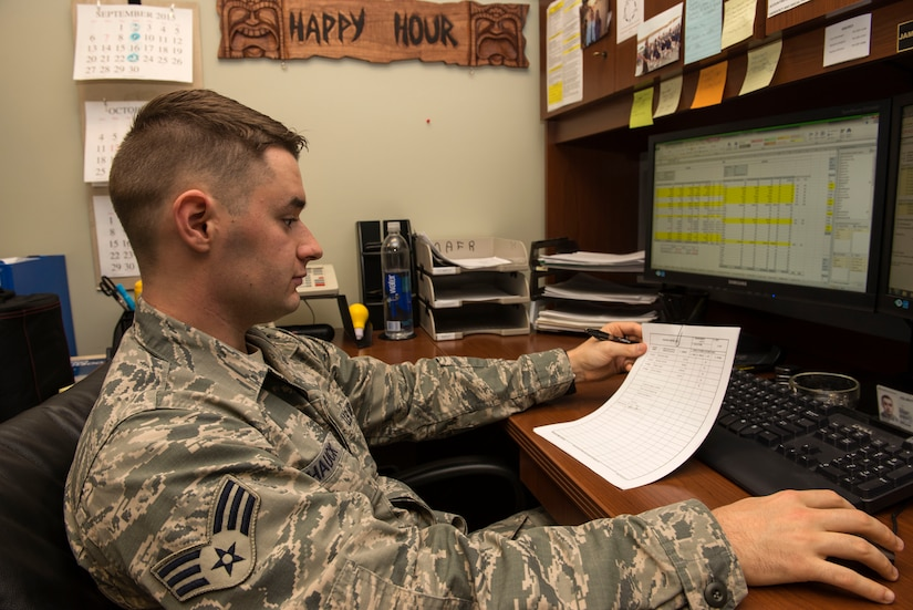 Senior Airman James Hauck, 628th Comptroller Squadron budget analyst, cross references accounts on the Defense Enterprise Accounting and Management System in the finance office on Joint Base Charleston – Air Base, S.C., Oct. 7, 2015. This is the first year that D.E.A.M.S. was fully integrated into the office.