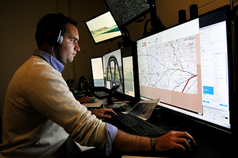 Nathan A. Hruska, simulator operator and maintainer for the 169th Air Support Operations Squadron, Illinois Air National Guard, programs a scenario in the Air National Guard Advanced Joint Terminal Attack Controller Training System during a training session at the 182nd Airlift Wing in Peoria, Ill., Oct. 5, 2015. Peoria's TACPs teamed up with the QuantaDyn Corporation to help create the AAJTS, which is expected to potentially save the government $95 million through fiscal year 2018 by reducing the cost of qualification and continuation training by 48 percent. (U.S. Air National Guard photo by Staff Sgt. Lealan Buehrer/Released)