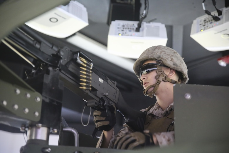 Lance Cpl. Luis Muniz, a motor transport operator with Transportation Support Co., Combat Logistics Battalion 2, mans an M240G medium machine gun during simulated High Mobility Multipurpose Wheeled Vehicle convoy training at Camp Lejeune, N.C., Oct. 7, 2015. Marines with the unit are undergoing Convoy Leader's Course in preparation for an Integrated Training Exercise in Twentynine Palms, Calif., later this month. (U.S. Marine Corps photo by Cpl. Lucas Hopkins/Released)