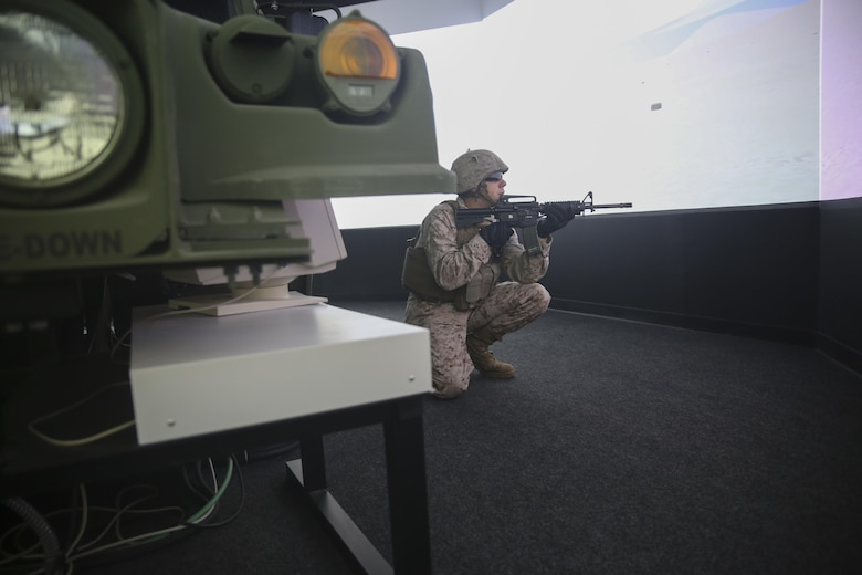 Lance Cpl. Ryan Leech, a motor transport operator with Transportation Support Co., Combat Logistics Battalion 2, posts security during simulated High Mobility Multipurpose Wheeled Vehicle convoy training at Camp Lejeune, N.C., Oct. 7, 2015. Marines with the unit are undergoing Convoy Leader's Course in preparation for an Integrated Training Exercise in Twentynine Palms, Calif., later this month. (U.S. Marine Corps photo by Cpl. Lucas Hopkins/Released)
