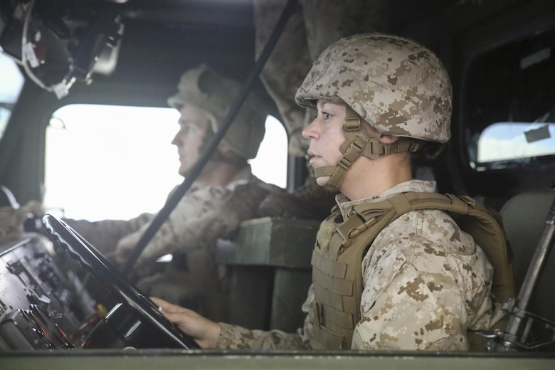 Cpl. Mason Archer, left, and Pfc. Crystal Canzius, right, both motor transport operators with Transportation Support Co., Combat Logistics Battalion 2, conduct simulated High Mobility Multipurpose Wheeled Vehicle convoy training at Camp Lejeune, N.C., Oct. 7, 2015. Approximately 25 Marines with the unit are undergoing Convoy Leader's Course in preparation for an Integrated Training Exercise in Twentynine Palms, Calif., later this month. (U.S. Marine Corps photo by Cpl. Lucas Hopkins/Released)