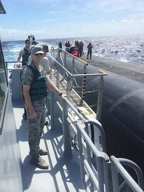 Capt. Cody daMota poses for a photo aboard the Personnel Transfer Vessel Malama during an open-ocean personnel transfer with a ballistic missile submarine, Aug. 15, 2015. DaMota is one of the first four Air Force intercontinental ballistic missile officers selected to serve with U.S. Navy Submarine Forces ballistic missile submarine units through the Striker Trident nuclear officer exchange program. (U.S. Air Force photo/Capt. Patrick McAfee)