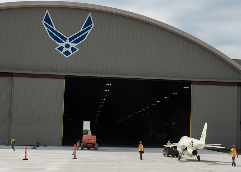 Restoration staff move the Bell X-5 into the new fourth building at the National Museum of the U.S. Air Force on Oct. 8, 2015. (U.S. Air Force photo by Ken LaRock)