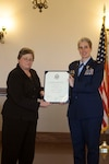 Sonya Gish, director of DLA Distribution process and planning directorate presents Air Force Col. Karen D. Stoff with a certificate of retirement from the United States Air Force.