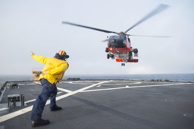 An HH-60 Jayhawk rescue helicopter lands on the flight deck of Coast Guard Cutter Healy in the southern Arctic Ocean, Oct. 7, 2015. The Healy is supporting the National Science Foundation-funded Arctic Geotraces project, part of an international effort to study the distribution of trace elements in the world's oceans. U.S. Coast Guard photo by Petty Officer 2nd Class Cory J. Mendenhall