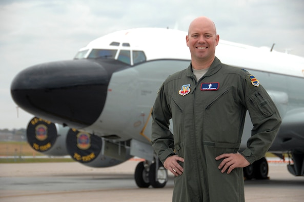 Chaplain (Capt.) Michael Farar poses in front of an RC-135 Rivet Joint aircraft at Offutt Air Force Base, Neb., Oct. 7, 2015. Farar is believed to be the first aerial-qualified chaplain to fly on operational missions with the 55th Wing and is also believed to be the first chaplain on aeronautical orders within Air Combat Command. (U.S. Air Force photo/Delanie Stafford)