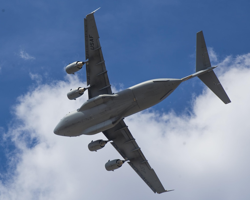 A C-17 Globemaster III flies over Biggs Army Airfield, Texas, during Bold Quest 15-2 operations Oct. 2, 2015. One main facet of Bold Quest was the integration of joint and coalition fire support assets across all warfighting domains. The Army and Air Force worked together to perform air-to-air, surface-to-air, and air-to-surface fire support engagements in live and digitally simulated missions. (U.S. Air Force photo/Airman 1st Class Emily A. Kenney)