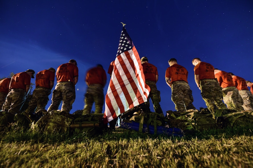 Special tactics Airmen bow their heads during a moment of prayer before the start of the 2015 Special Tactics Memorial Ruck March at Joint Base San Antonio-Lackland, Texas, Oct. 4, 2015. The march covered 812 miles with every Airman carrying a 50-pound ruck, ending at Hurlburt Field, Fla. The march is to bring awareness to the service and sacrifice of special tactics members and in memory of fallen comrades since 9/11. (U.S. Air Force photo/Senior Airman Taylor Curry)