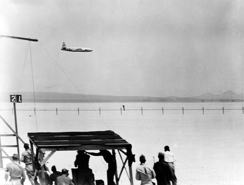 P-80R flying past a speed marking station at Muroc Army Air Field. On June 19, 1947, at Muroc Army Air Field (now Edwards Air Force Base), Calif., Col. Albert Boyd flew this P-80R to a new world's speed record of 623.753 mph, returning the record to the United States after nearly 24 years. (U.S. Air Force photo)