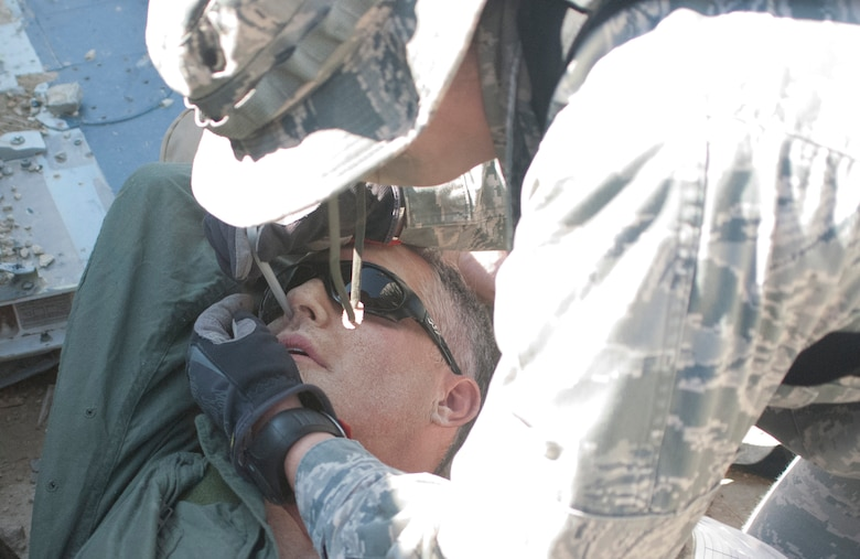 An Airman from the 460th Medical Group clears a patient's airway during a training exercise Oct. 3, 2015, at Fort Carson, Colo. The 460th MDG completed annual combat leadership and combat medic training in order to prepare themselves for situations they could find themselves in while deployed in a hostile environment. (Courtesy photo)