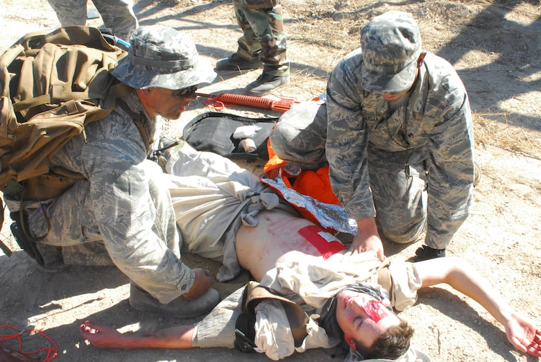 Airmen from the 460th Medical Group care for a patient during a training exercise Oct. 3, 2015, at Fort Carson, Colo. The 460th MDG completed annual combat leadership and combat medic training in order to prepare themselves for situations they could find themselves in while deployed in a hostile environment. (Courtesy photo)