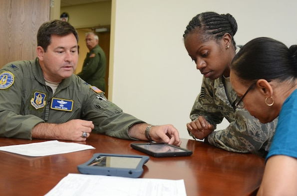 Col. Kevin Webb, Air Force Reserve Command Chief of Mobility Operations Division, demonstrates some of the functions of the Mobile Mission Kit during a test phase of the unit held at Dobbins Air Reserve Base, Ga. Sept. 29, 2015.  The device is designed to capture a wide variety of accurate and timely mission data using a paperless and real-time process, reducing crew workload, saving costs and improving overall efficiency before, during and after flying missions. (U.S. Air Force photo/Don Peek)