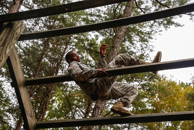 U.S. Army Sgt. Kristopher A. Grayson participates in the obstacle course portion of the U.S Army's Best Warrior Competition on Fort A.P. Hill, Va., Oct. 5, 2015. The weeklong competition tests the skills, knowledge and professionalism of 26 warriors representing 13 commands. Grayson is assigned to Headquarters and Headquarters Company, 53rd Signal Battalion, U.S. Army Space and Missile Defense Command. U.S. Army photo by Spc. Wes Conroy