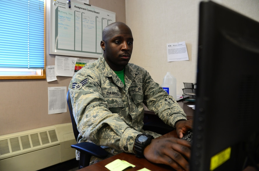 U.S. Air Force Senior Airman Devarius Dawkins, a 354th Force Support Squadron readiness and plans journeyman, checks over personnel training records Oct. 9, 2015, at Eielson Air Force Base, Alaska. Dawkins uses these records to make sure personnel are up-to-date on all required training. (U.S. Air Force photo by Airman 1st Class Cassandra Whitman/Released)