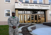 U.S. Air Force Senior Airman Devarius Dawkins, a 354th Force Support Squadron readiness and plans journeyman, takes a quick break outside Amber Hall, Oct. 9, 2015, at Eielson Air Force Base, Alaska. Dawkins said his favorite part of his job is working under pressure. (U.S. Air Force photo by Airman 1st Class Cassandra Whitman/Released)