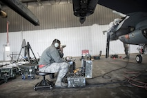 "U.S. Air Force Senior Airman Terrence Lawrence, 354th Aircraft Maintenance Squadron aircraft electrical and environmental systems journeyman, troubleshoots an F-16 Fighting Falcon assigned to the 18th Aggressor Squadron at Eieson Air Force Base, Alaska, Oct. 7, 2015. Lawrence was the first Airman to complete a program called ""cut training,"" which cross utilizes Airmen to fill undermanned crew chief positions. (U.S. Air Force photo by Staff Sgt. Joshua Turner/Released)"