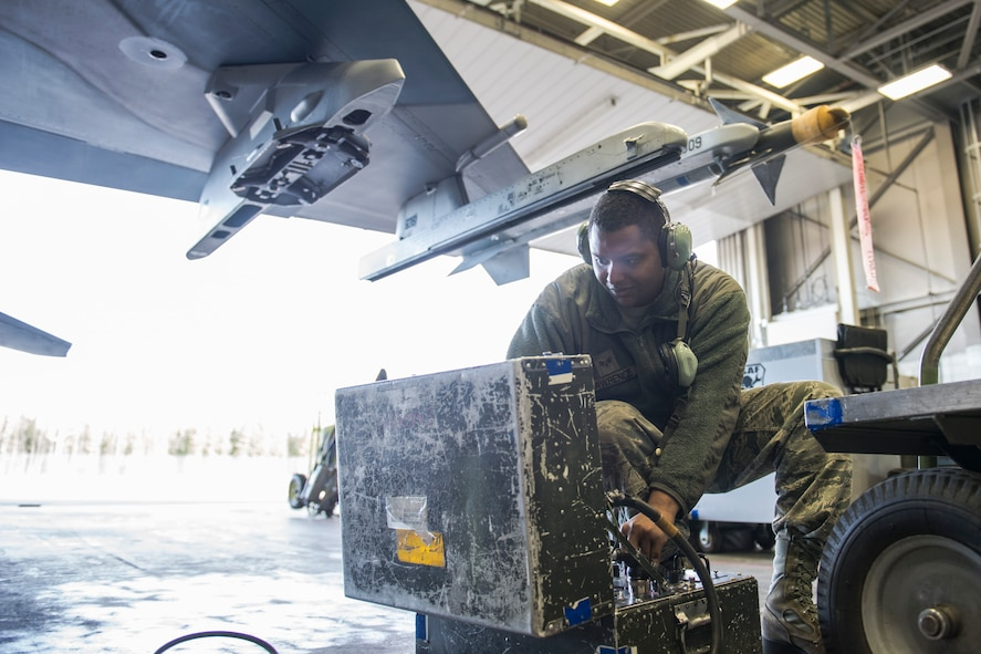 U.S. Air Force Senior Airman Terrence Lawrence, a 354th Aircraft Maintenance Squadron aircraft electrical and environmental systems journeyman, troubleshoots an F-16 Fighting Falcon assigned to the 18th Aggressor Squadron at Eielson Air Force Base, Alaska, Oct. 7, 2015. Lawrence is cross utilized from a different maintenance career field to perform crew chief tasks because crew chiefs are undermanned 50 percent. (U.S. Air Force photo by Staff Sgt. Joshua Turner/Released)