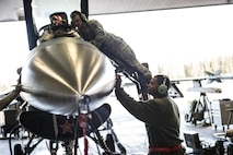 U.S. Air Force Senior Airman Terrence Lawrence, a 354th Aircraft Maintenance Squadron aircraft electrical and environmental systems journeyman, checks a sensor on an F-16 Fighting Falcon aircraft assigned to the 18th Aggressor Squadron at Eielson Air Force Base, Alaska, Oct. 7, 2015. Lawrence is cross utilized from a different maintenance career field to perform crew chief tasks because crew chiefs are undermanned 50 percent. (U.S. Air Force photo by Staff Sgt. Joshua Turner/Released)
