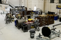 U.S. Airmen assigned to the 354th Maintenance Squadron service an F110-GE-100C jet engine Oct. 8, 2015, in the engine shop at Eielson Air Force Base, Alaska. The maintainers disassembled the engine and inspected every component for potential damage before starting repairs. (U.S. Air Force photo by Senior Airman Peter Reft/Released)