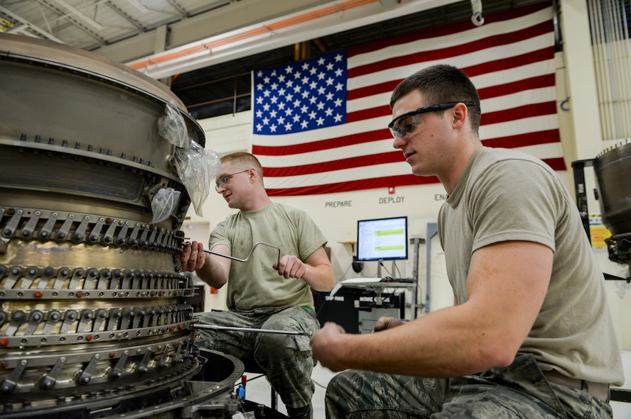 U.S. Air Force Senior Airmen Andrew Piercy and Cody Bowman, both 354th Maintenance Squadron aerospace propulsion journeymen, disassemble an F110-GE-100C engine compressor Oct. 8, 2015, in the engine shop at Eielson Air Force Base, Alaska.  Piercy and Bowman were involved in an aircraft engine rebuild, a detail-demanding process that can take several months to complete.  (U.S. Air Force photo by Senior Airman Peter Reft/Released)
