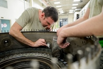 U.S. Air Force Staff Sgt. Jonathan Royder, a 354th Maintenance Squadron aerospace propulsion craftsman, extracts bolts from a combustion diffuser nozzle assembly Oct. 8, 2015, in the engine shop at Eielson Air Force Base, Alaska. Royder serviced the jet engine as part of an engine rebuild involving a complete tear down and inspection of all parts. (U.S. Air Force photo by Senior Airman Peter Reft/Released)