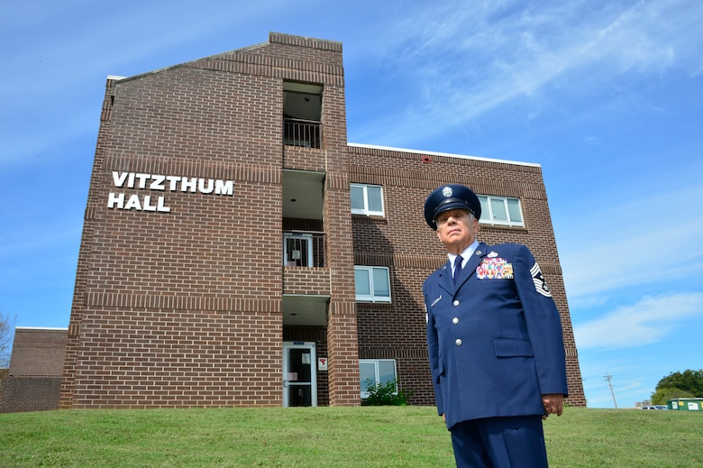 MCGHEE TYSON AIR NATIONAL GUARD BASE, Tenn. - Retired Chief Master Sgt. George A. Vitzthum stands by the building in his name that was dedicated here Oct 8, 2015, with a celebration and ceremony with I.G. Brown Training and Education Center staff, friends and family. (U.S. Air National Guard photo by Master Sgt. Jerry Harlan/Released)
