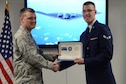 Maj. Adam MacKenzie, 361st Training Squadron commander, presents Airman 1st Class Andrew Richter, 361st TRS aerospace propulsion graduate, with the ACE award during the class graduation at Sheppard Air Force Base, Texas, Oct. 7, 2015.  Richter earned the ACE award for maintaining a perfect score through the entire seven blocks of course instruction. (U.S. Air Force photo/Tech. Sgt. Mike Meares)