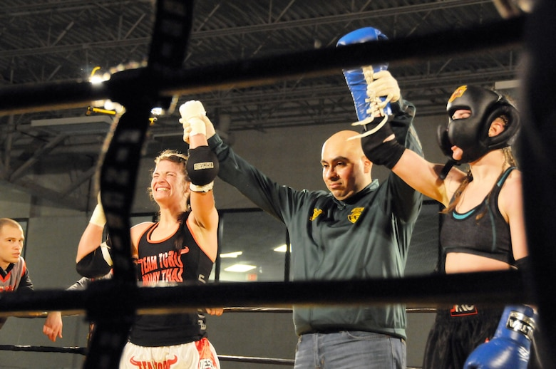 Tech. Sgt. Destiny Taylor, 110th Attack Wing Comptroller Flight claimed victory in her third Muay Thai full contact fight, Saturday, March 7, 2015, Wings Stadium, Kalamazoo Mich. Sgt Taylor has been practicing Muay Thai for two years. (Air National Guard photo by Tech. Sgt. Timothy Diephouse/Released)