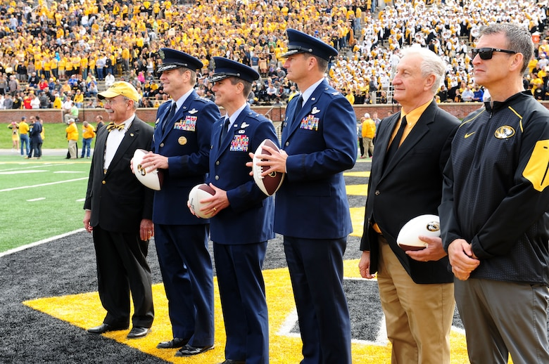 From left, R. Bowen Loftin, University of Missouri chancellor, Gen. Robin Rand, Air Force Global Strike Command commander, Brig. Gen. Paul Tibbets IV, 509th Bomb Wing commander, Col. Michael Francis, 131st Bomb Wing commander, Joe Scallorns, AFGSC civic leader, and Mack Rhoades, University of Missouri director of athletics, stand on the end zone at Faurot Field Oct. 3, 2015, in Columbia, Mo. Each commander and Scallorns received a commemorative football from Rhoades, as part of Mizzou's military appreciation game. (U.S. Air Force photo by Airman 1st Class Jazmin Smith/Released)