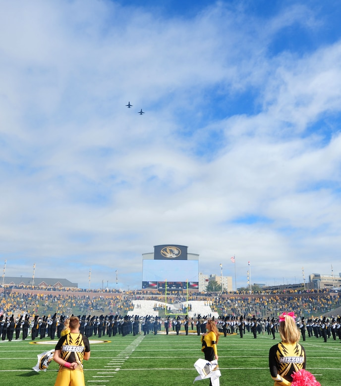 Two T-38 Talons perform a flyover at the University of Missouri football game Oct. 3, 2015, in Columbia, Mo. More than 500 members from Team Whiteman attended the military appreciation game at Mizzou. (U.S. Air Force photo by Airman 1st Class Jazmin Smith/Released)