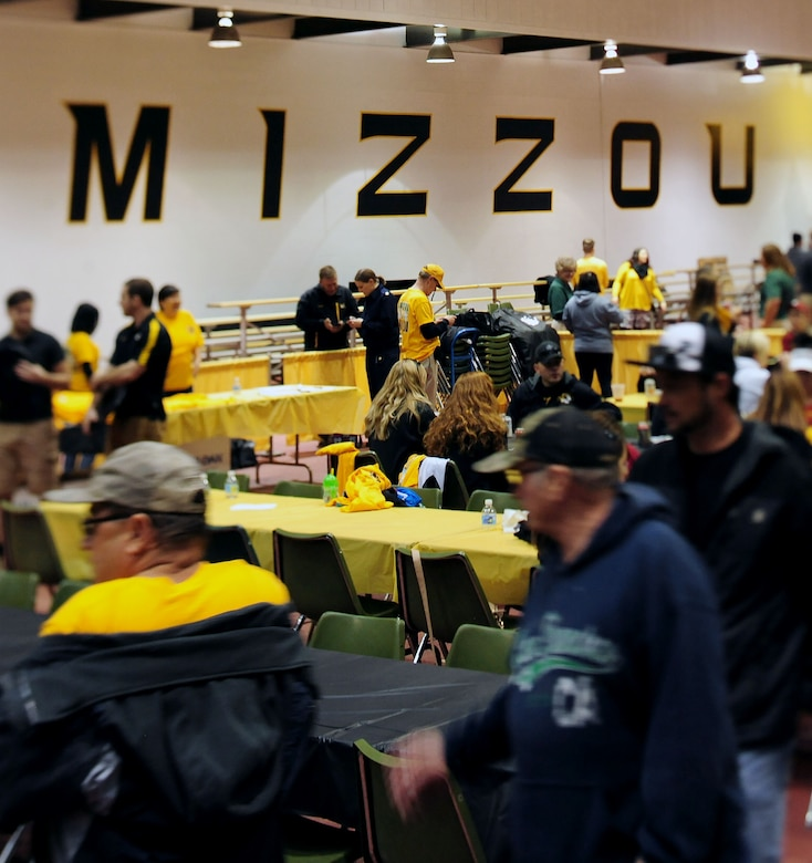 "Members from Team Whiteman attend a free ""tailgate"" event at the Hearnes Fieldhouse Oct. 3, 2015, in Columbia, Mo. The tailgate event at the University of Missouri offered food, drinks and commemorative military appreciation day shirts for service members and their families. Entertainment was provided by the MU cheerleaders, golden girls and the Marching Mizzou band. (U.S. Air Force photo by Airman 1st Class Jazmin Smith/Released)"