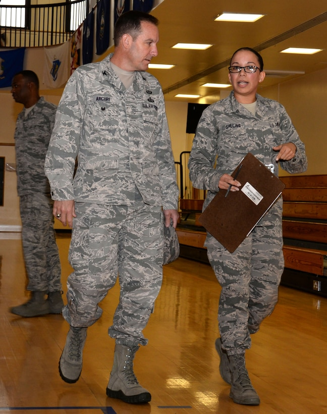 U.S. Air Force Col. Scott Arcuri, left, U.S. Air Forces in Europe - Air Forces Africa director of manpower, personnel, services, speaks with U.S. Air Force Staff Sgt. Lateasha Shilling, 100th Force Support Squadron NCO in charge of the fitness center, during his tour of the Hardstand Fitness Center Oct. 7, 2015, on RAF Mildenhall, England. Arcuri toured many areas of the facility including the weight rooms, indoor running track, basketball court and therapy rooms. (U.S. Air Force photo by Gina Randall/Released)