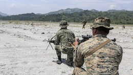 Philippine Marines and U.S. Marines execute squad attacks at Crow Valley, Philippines, Oct. 4, 2015. Philippine Marines and U.S. Marines with Battalion Landing Team 2nd Battalion, 5th Marine Regiment, 31st Marine Expeditionary Unit, are training side by side for Amphibious Landing Exercise 2015, an annual bilateral training exercise conducted by members of the Armed Forces of the Philippines alongside U.S. Marine and Navy Forces.