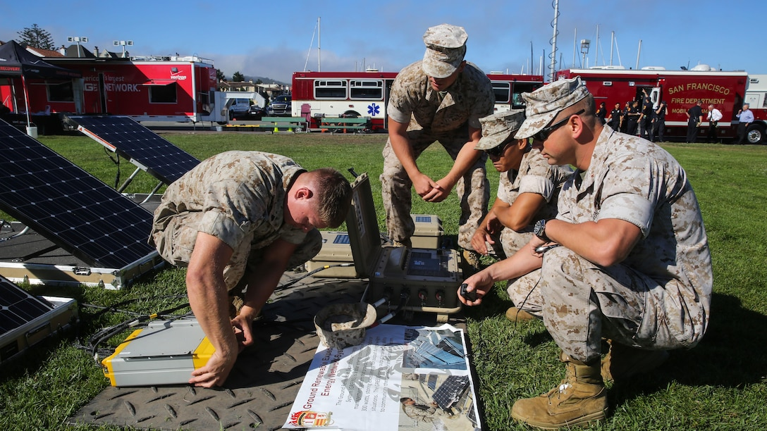 Marines with 1st Marine Logistics Group, 1st Marine Division, assemble solar panels during a humanitarian assistance and disaster relief static display at Marina Green Beach, Ssn Francisco, Oct. 9, 2015, as part of San Francisco Fleet Week 2015. SFFW 15' is a week-long event that blends a unique training and education program, bringing together key civilian emergency responders and Naval crisis-response forces to exchange best practices focused on humanitarian assistance disaster relief with particular emphasis on defense support to civil authorities.