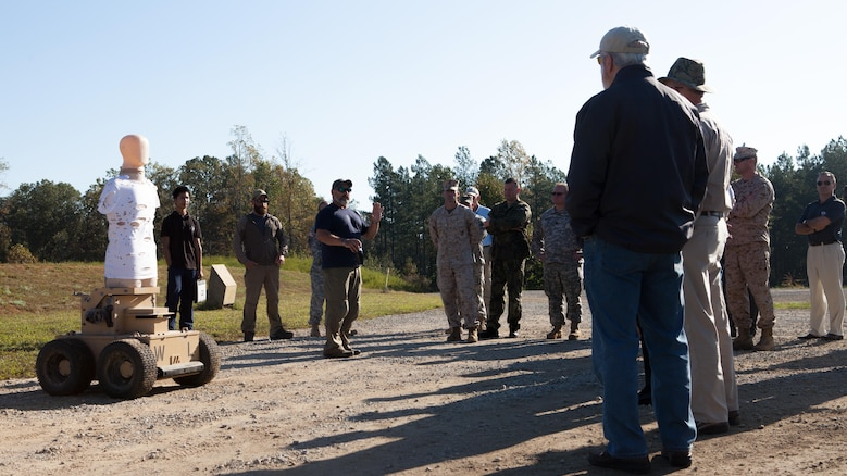 Representatives of numerous government agencies are educated on the robotic human type target at Fort A.P. Hill, Va., Oct. 10, 2015. Robotic targets help to compile data for the Joint Sniper Performance Improvement Methodology Quick Reaction Test. This yearlong test aims to improve the skills of snipers across all United States' government agencies.