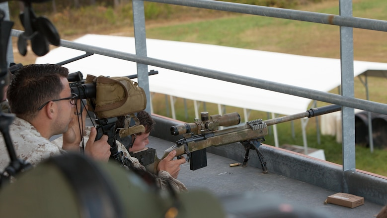 A Marine Corps sniper and his spotter attempt to shoot a robotic moving target at 600 meters at Fort A.P. Hill, Va., Oct. 10, 2015. The data about the shots fired are collected for the Joint Sniper Performance Improvement Methodology Quick Reaction Test. This yearlong test aims to improve the skill of snipers across all United States' government agencies.
