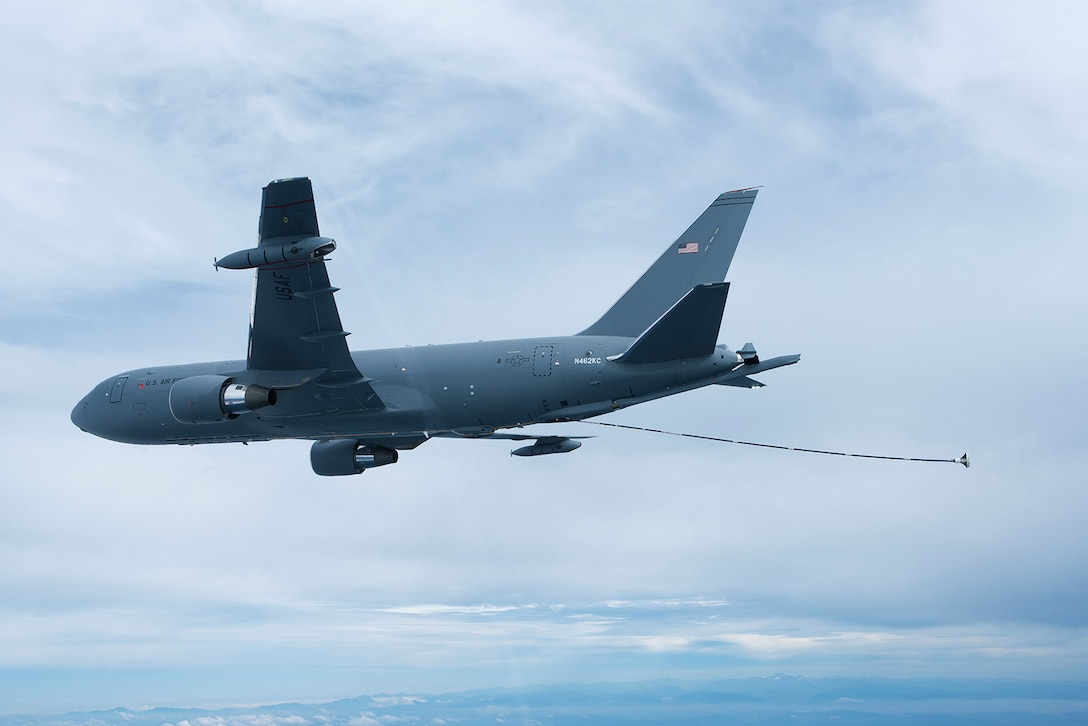 The KC-46A Pegasus tanker deploys the Centerline Drogue System located on the belly of the fuselage on Oct. 8.  The drogue system is used to refuel probe receiver aircraft.   (Boeing photo by John D. Parker)