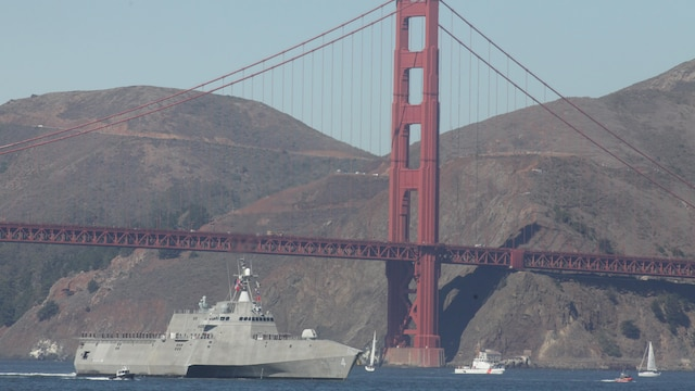 A U.S. Navy ship passes under the Golden Gate Bridge during the parade of ships event as part of San Francisco Fleet Week 2015, Oct. 9, 2015. The parade of ships is a traditional part of Fleet Week in which service members and San Francisco natives pay respects to the ships who pass through the harbor. SFFW 15' is a week-long event that blends a unique training and education program, bringing together key civilian emergency responders and Naval crisis-response forces to exchange best practices on humanitarian assistance disaster relief with particular emphasis on defense support to civil authorities.