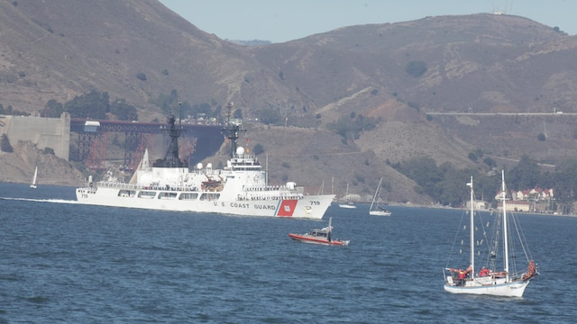 A Coast Guard cutter passes through San Francisco Bay during the parade of ships event as part of San Francisco Fleet Week 2015, Oct. 9, 2015. The parade of ships is a traditional part of Fleet Week in which service members and San Francisco natives pay respects to the ships who pass through the harbor. SFFW 15' is a week-long event that blends a unique training and education program, bringing together key civilian emergency responders and Naval crisis-response forces to exchange best practices on humanitarian assistance disaster relief with particular emphasis on defense support to civil authorities.