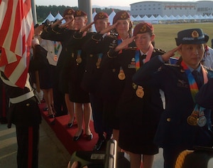 Team USA members salute the colors after being awarded gold for formation skydiving at the CISM World Games in South Korea, Oct. 8, 2015. From front to back are: Sgts. 1st Class Jennifer Davidson, Laura Davis, Scott Janice, Angela Nichols and Dannielle Woosley.