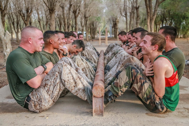 U.S. Marines with the 15th Marine Expeditionary Unit and the French 5th Overseas Combined Arms Regiment (RIAOM) perform crunches as part of indoctrination prior to participating in a desert survival course. Elements of the 15th MEU are training with the 5th RIAOM in Djibouti in order to improve interoperability between the MEU and the French military.