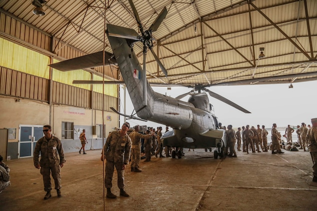 U.S. Marines with the 15th Marine Expeditionary Unit get an overview of the capabilities and structure of a French Aérospatiale SA 330 Puma helicopter. Elements of the 15th MEU are training with the 5th RIAOM in Djibouti in order to improve interoperability between the MEU and the French military. (U.S. Marine Corps photo by Sgt. Steve H. Lopez/Released)