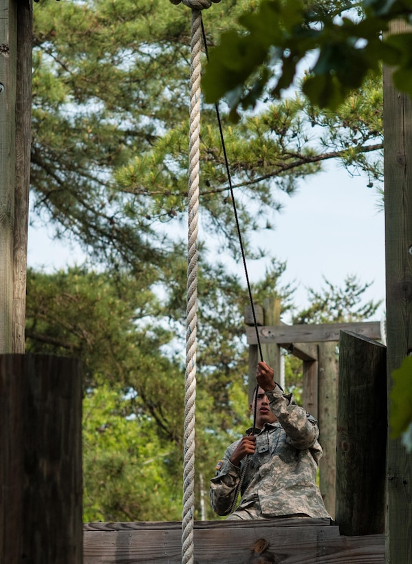 """Sgt. Josue Lebron, representing the 1st Mission Support Command in Puerto Rico, completes an obstacle at the """"Little Nasty Nick"""" obstacle course at the 2015 U.S. Army Reserve Best Warrior Competition at Fort Bragg, N.C., May 6. This year's Army Reserve Best Warrior Competition will determine the top noncommissioned officer and junior enlisted Soldier who will represent the Army Reserve in the Department of the Army Best Warrior competition in October at Fort Lee, Va. (U.S. Army photo by Timothy L. Hale/Released)"""