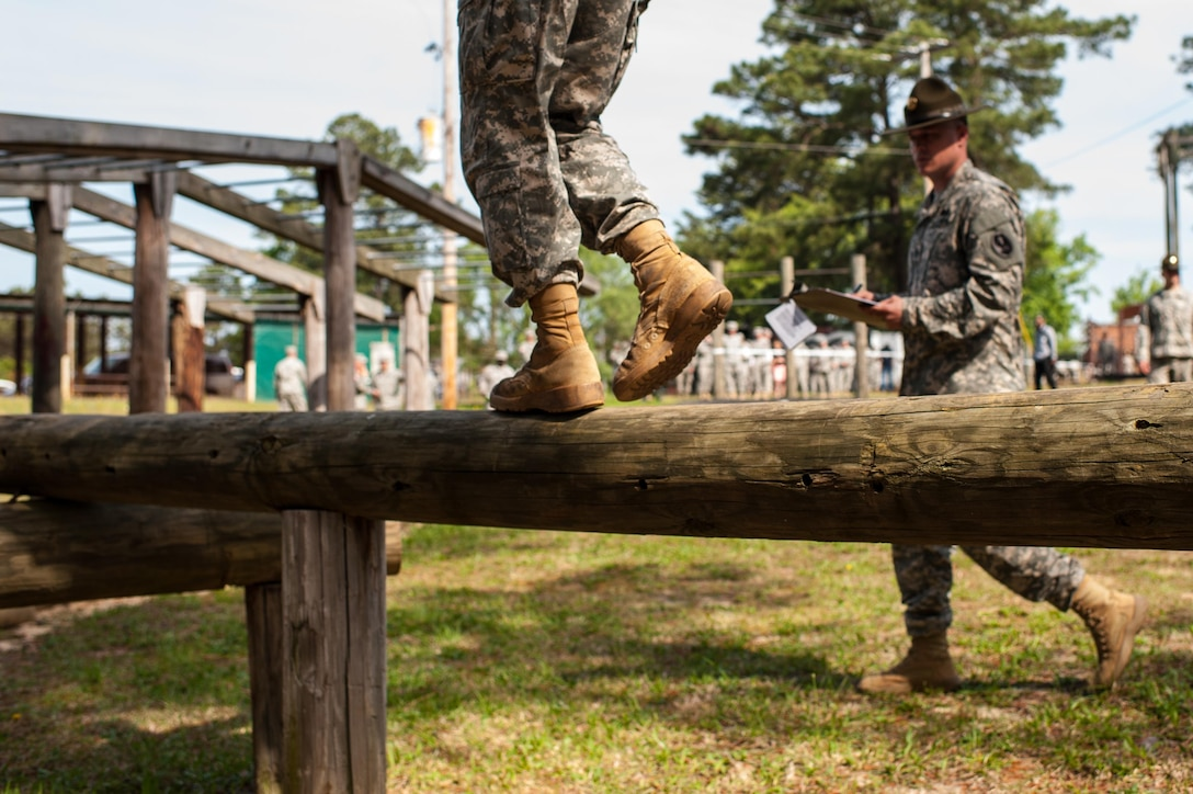 """A U.S. Army Reserve drill sergeant from 2nd Battalion, 397th Regiment, 95th Training Division (Initial Entry Training), watches a competitor complete an obstacle at the """"Little Nasty Nick"""" obstacle course at the 2015 U.S. Army Reserve Best Warrior Competition at Fort Bragg, N.C., May 6. This year's Army Reserve Best Warrior Competition will determine the top noncommissioned officer and junior enlisted Soldier who will represent the Army Reserve in the Department of the Army Best Warrior competition in October at Fort Lee, Va. (U.S. Army photo by Timothy L. Hale/Released)"""