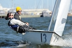 Members of the U.S. Naval Academy's varsity offshore sailing team steer a Club FJ sailboat in Maryland's Severn River. DLA recently helped the academy donate 21 of the small watercraft to the SUNY Maritime Academy in New York City.