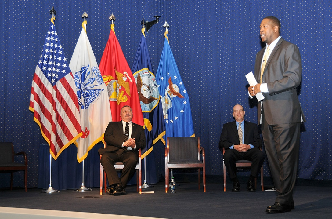 Kenyata Wesley, right, acting director of the Defense Department office of small business programs, speaks to Defense Logistics Agency acquisition professionals at the McNamara Headquarters Complex July 23 during the DLA small business and acquisition broadcast.