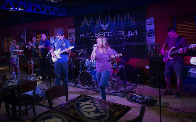 """The U.S. Air Force's Central Command Band, Full Spectrum, performs at the Fox Sports Lounge at Al Udeid Air Base, Qatar Oct. 13, 2015. The performance, which featured hit songs """"Uptown Funk,"""" """"Beat It,"""" and """"Superstitious"""" was the band's last before the group kicks off a 16-day tour. (U.S. Air Force Photo/Tech. Sgt. James Hodgman)"""