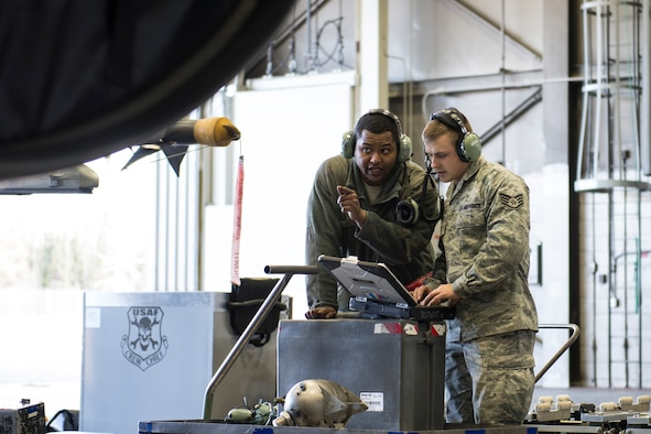 Senior Airman Terrence Lawrence and Staff Sgt. Eric Fitch, both 354th Aircraft Maintenance Squadron maintenance specialists, troubleshoot an F-16 Fighting Falcon assigned to the 18th Aggressor Squadron at Eielson Air Force Base, Alaska, Oct. 7, 2015. Lawrence was the first Airman to complete a program called Cut Training, which cross utilizes Airmen to fill undermanned crew chief positions. (U.S. Air Force photo/Staff Sgt. Joshua Turner)