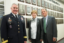 Brig. Gen. Richard Kaiser, Tom N. Porter, P.E. and his wife pose at the wall of the Gallery of Distinguished Civilians following a ceremony in Cincinnat, Ohio.