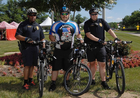 DLA Police Sgt. James Sprecher, center, and other members of the DLA Police bike team display the trophy Sprecher received for participating in the 250-mile Law Enforcement United Road to Hope, pose during the McNamara Headquarters Complex Family Day June 24.
